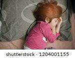 asian girl sleep on bed  kid...   Shutterstock . vector #1204001155