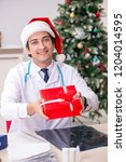 doctor with gift box in the...   Shutterstock . vector #1204014595