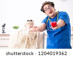 funny doctor with skeleton in...   Shutterstock . vector #1204019362