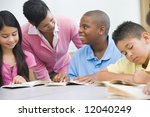 teacher working with elementary ... | Shutterstock . vector #12040249