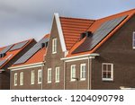 modern row houses with solar...   Shutterstock . vector #1204090798