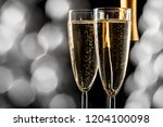 two glasses of sparkling wine | Shutterstock . vector #1204100098