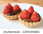 mouthwatering a pair of... | Shutterstock . vector #1204104682