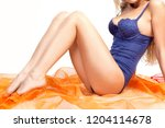 slim smooth shaved woman legs.... | Shutterstock . vector #1204114678