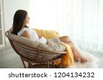 beautiful pregnant woman... | Shutterstock . vector #1204134232