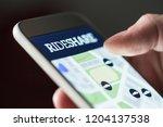 ride share app in smartphone.... | Shutterstock . vector #1204137538