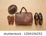 brown handbag with leather... | Shutterstock . vector #1204156252