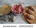 prepare chops on a gray... | Shutterstock . vector #1204224622