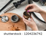 filling a hookah bowl with... | Shutterstock . vector #1204236742