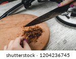 slicing the fragrant tobacco... | Shutterstock . vector #1204236745