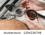 filling a hookah bowl with... | Shutterstock . vector #1204236748