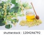 jar of linden honey with fresh... | Shutterstock . vector #1204246792