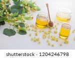 jar of linden honey with fresh... | Shutterstock . vector #1204246798