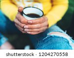 girl holding in hands cup of...   Shutterstock . vector #1204270558