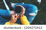 top view girl holding in hands... | Shutterstock . vector #1204272412