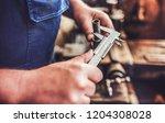 workman in uniform working on... | Shutterstock . vector #1204308028