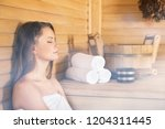 young woman relaxing in spa... | Shutterstock . vector #1204311445