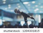 microphone in seminar room | Shutterstock . vector #1204331815