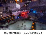 model with a miniature  where a ... | Shutterstock . vector #1204345195