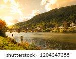 old bridge across neckar river... | Shutterstock . vector #1204347355