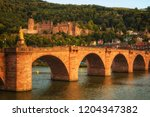 the old bridge across neckar... | Shutterstock . vector #1204347382