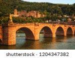 the old bridge across neckar... | Shutterstock . vector #1204347382