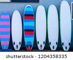 surfboards in a row   Shutterstock . vector #1204358335