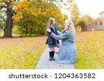 mother and daughter at park in... | Shutterstock . vector #1204363582