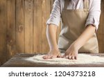 making dough by female hands at ... | Shutterstock . vector #1204373218