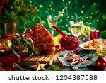 glazed roast ham with cloves... | Shutterstock . vector #1204387588