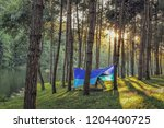view of camping tent on the... | Shutterstock . vector #1204400725