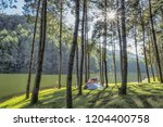view of camping tent on the... | Shutterstock . vector #1204400758