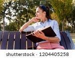 cheerfull  young woman  holding ... | Shutterstock . vector #1204405258
