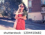 beautiful shopaholic. beautiful ... | Shutterstock . vector #1204410682