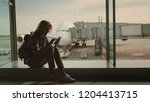 a female passenger sits on the... | Shutterstock . vector #1204413715