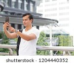 handsome man take a selfie in... | Shutterstock . vector #1204440352