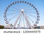 white ferris wheel from bottom...
