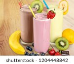 fruit smoothies with straws | Shutterstock . vector #1204448842