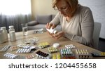 old female taking capsules from ... | Shutterstock . vector #1204455658