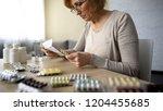 senior lady reading instruction ... | Shutterstock . vector #1204455685
