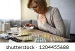 senior lady feeling unwell ... | Shutterstock . vector #1204455688