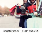 portrait of happy couple with... | Shutterstock . vector #1204456915