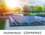 floating solar panels or solar... | Shutterstock . vector #1204469662