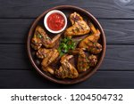 hot bbq . grilled chicken wings ... | Shutterstock . vector #1204504732