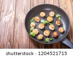 fried scallops with lemon and... | Shutterstock . vector #1204521715