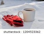 warm red gloves with black bow... | Shutterstock . vector #1204523362