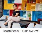 stylish african american woman... | Shutterstock . vector #1204569295