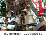 Small photo of Translation: The bells and stuff at Kali Hindu Temple on top of the hill in Dhulikhel