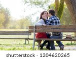 portrait of young couple in... | Shutterstock . vector #1204620265