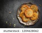 homemade diwali sweets chirote  ...   Shutterstock . vector #1204628062